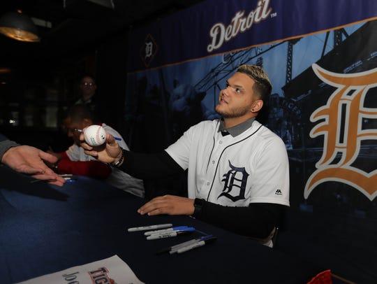 Tigers pitcher Joe Jimenez signs autographs during