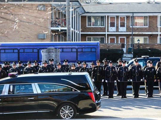 Police officers from across Michigan line up in formation along 7 mile road at the funeral for fallen Detroit Police officer Glenn Doss at Greater Grace Temple in Detroit on Friday, Feb. 2, 2018.
