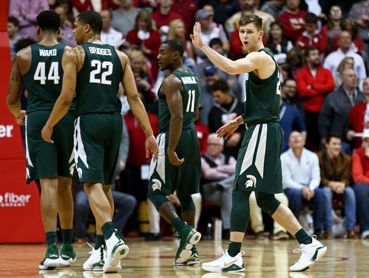 Michigan State Spartans guard Matt McQuaid (right)