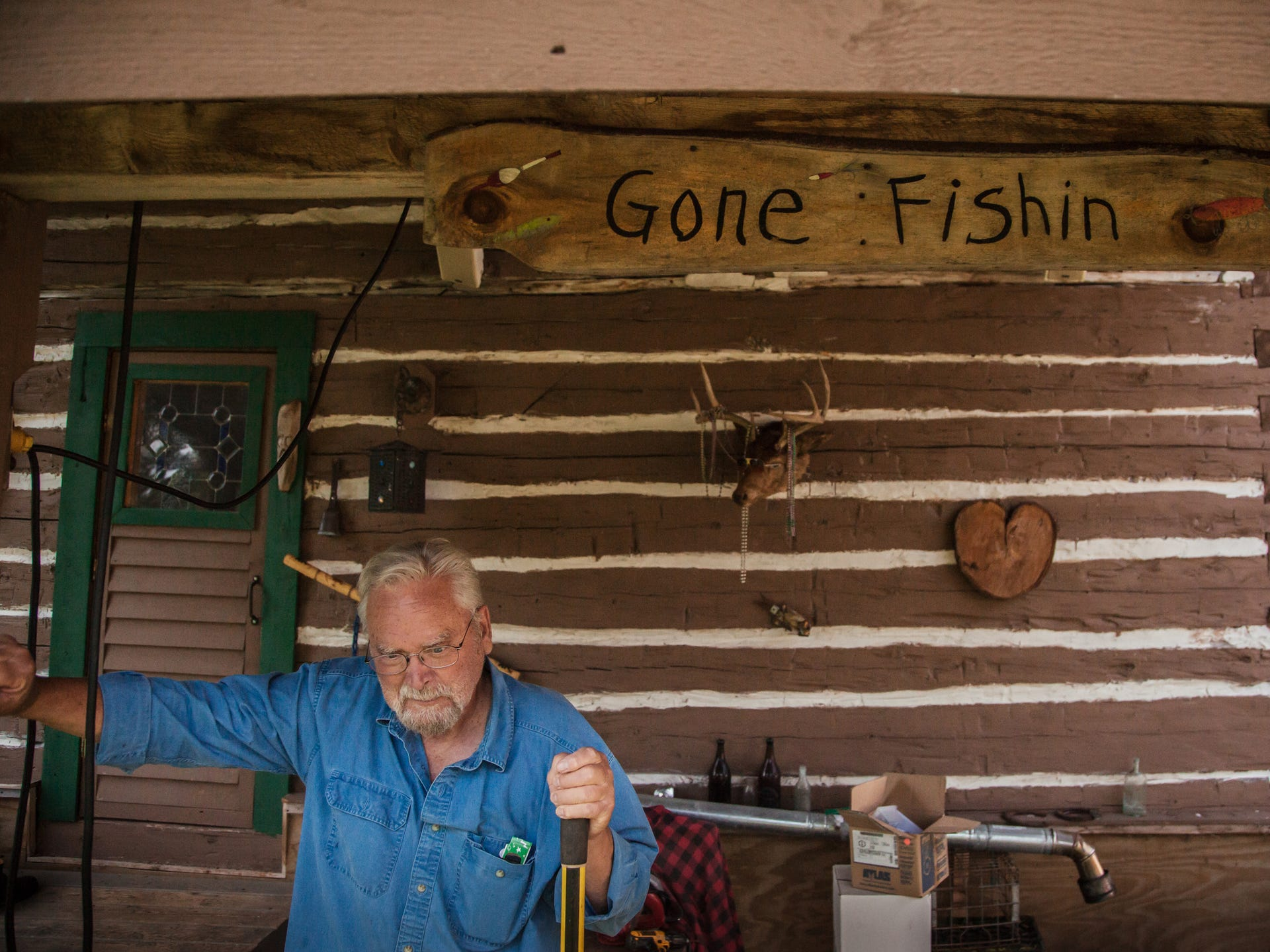 Jim Vivian, 74, stands outside his cabin in Central