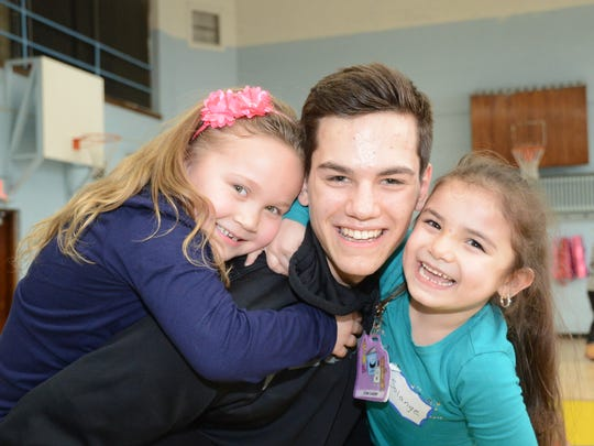 Northville hockey player Larry Rife made some new friends at Detroit' Neinas Elementary.