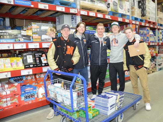 Northville hockey players (from left) Nick Bogenhagen, Tyler Balok, Anthony Salamone, Joe Tobon and Noah Eckerle shopped for healthy snacks and school supplies to donate to Detroit's Neinas Elementary School.