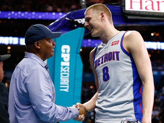 Feb 25, 2018; Charlotte, NC, USA; Detroit Pistons forward Henry Ellenson talks with former Detroit Lions head coach Jim Caldwell after the game against the Charlotte Hornets at Spectrum Center.