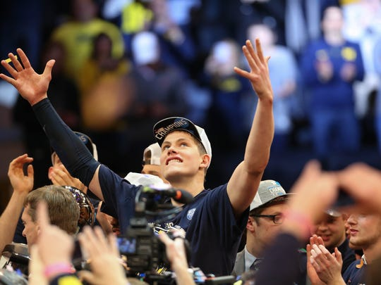 Michigan forward Moritz Wagner celebrates after winning