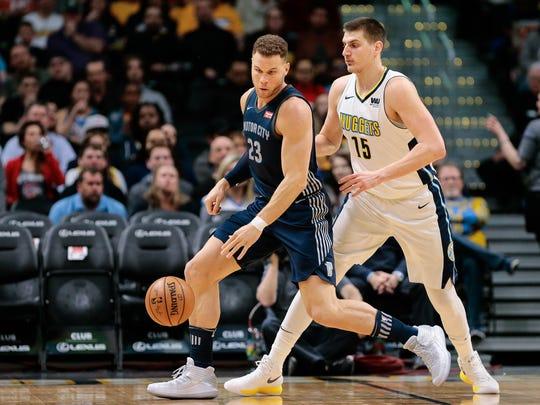Nuggets center Nikola Jokic guards Pistons forward Blake Griffin last season in Denver.