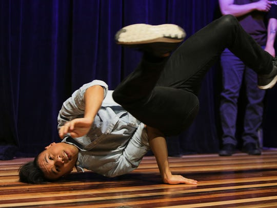 A breakdance group from Michigan State performs during an intermission at the Poetry Room at the Robin Theatre on February 27th, 2018.