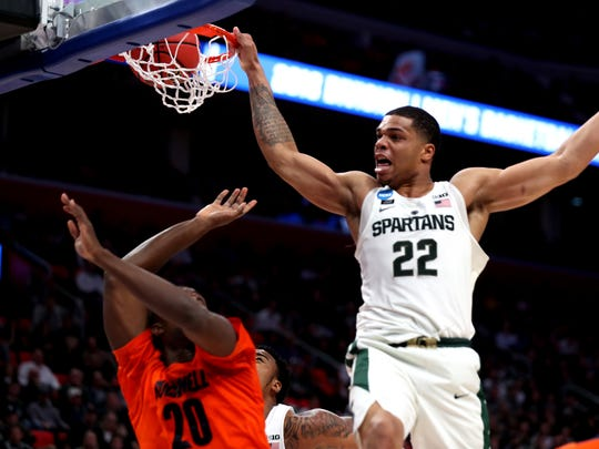 Michigan State's Miles Bridges dunks over Bucknell in the second half in the first round of the 2018 NCAA tournament at Little Caesars Arena, Friday, March 16.