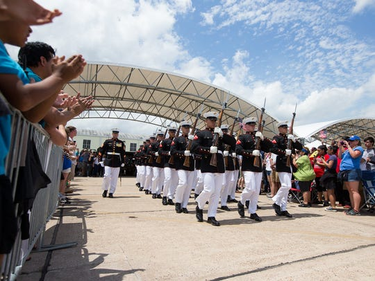 The United States Marine Corps Silent Drill Platoon performs during the Wings Over South Texas air show at the Naval Air Station Kingsville, Saturday, April 9, 2016.