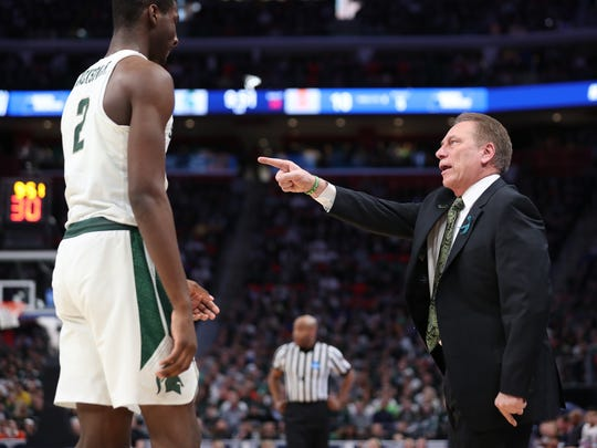 Michigan State's Jaren Jackson gets instructed by coach Tom Izzo in the first half of action against Syracuse in the second round of the NCAA tournament at Little Caesars Arena on Sunday, March 18, 2018.