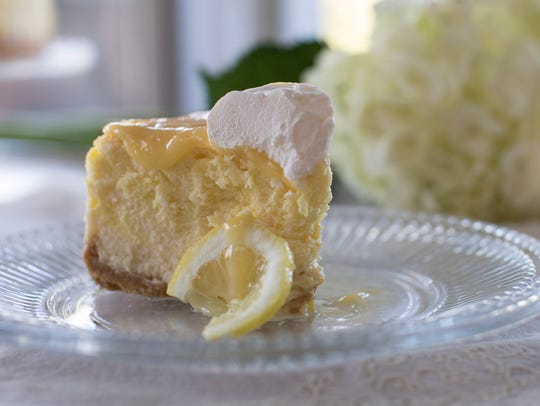 Dreamy Lemon Cheesecake has a crust made from sandwich cookies and a lemon curd topping.