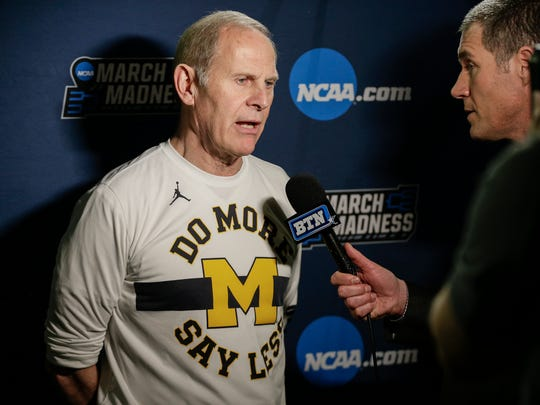 Michigan coach John Beilein talks to media members