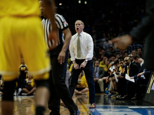 John Beilein reacts to a play during the Elite Eight against FSU on Saturday. Michigan has a program-record 32 wins this season.