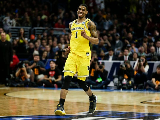 Michigan's Charles Matthews celebrates a play during