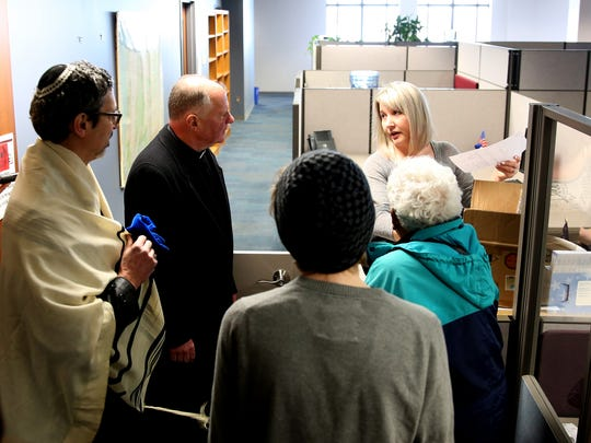 Supporters of Initiative Petition 43 drop off more than 3,000 signatures to Lydia Plukchi, a compliance specialist with the Secretary of State Elections Division, to be verified in Salem on Monday, March 26, 2018. The initiative would restrict the sale, production and ownership of assault weapons and high-capacity magazines.