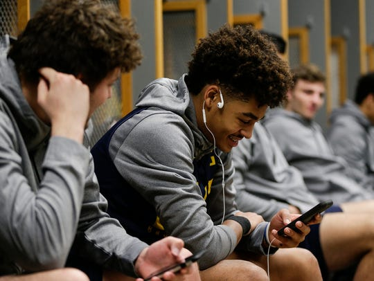 Michigan guard Jordan Poole, center, is seen in the