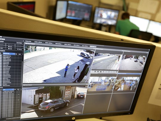 The video screens in the real time crime center at