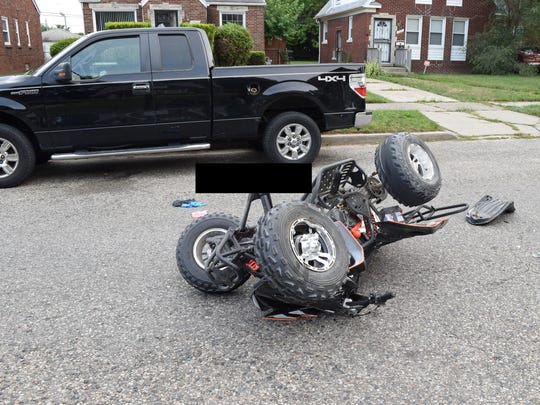 An ATV driven by Damon Grimes crashed into the back of a parked truck in Detroit on Aug. 26, 2017, remains on the scene after its driver was taken to a hospital. He later died. The black box seen in the photo was added by Michigan State Police.