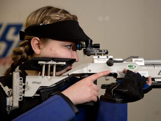 Taylor Gibson, 17, a junior at North Salem High School, will compete in the precision air rifle marksmanship competition at the Junior Olympics in Colorado on April 17-18. Photographed at the Four Corners Rod and Gun Club in Salem on Wednesday, April 11, 2018.