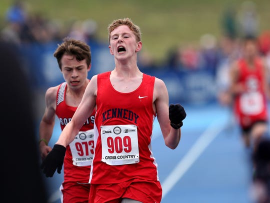 Kennedy's Luke Hall crosses the finish line in the