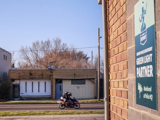 A motorcycle drives past the scene where a homicide occurred outside an after hours bar on Detroit's east side at Westphalia and East 7 Mile earlier this year on Thursday, April 19, 2018, across the street from a laundry mat that is a Green Light Partner with the City of Detroit.