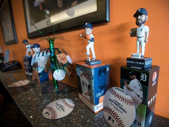 Detroit Tigers players bubbleheads and other gifts are also given to Kyle Van Houten of Hartland (not in the photo) at Comerica Park in Detroit, Friday, April 20, 2018.