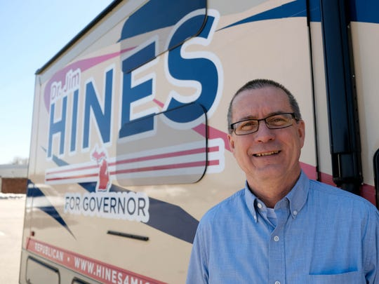 Republican gubernatorial candidate Dr. Jim Hines, a Saginaw physician, with his mobile campaign vehicle while parked in Saginaw on Friday, April 20, 2018.