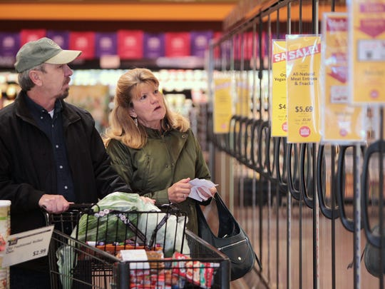 Ron and Kat Gordon, from Logansport, Ind., shop at Whole Foods Market in Carmel on March 18, 2014.