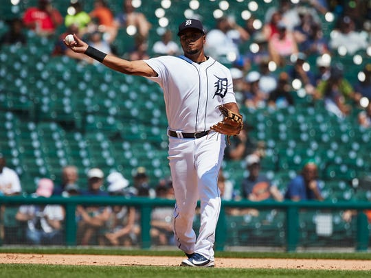 Jun 28, 2018; Detroit, MI, USA; Detroit Tigers third baseman Jeimer Candelario (46) makes a throw to first to get Oakland Athletics first baseman Matt Olson (not pictured) out in the eighth inning at Comerica Park on June 28, 2018.