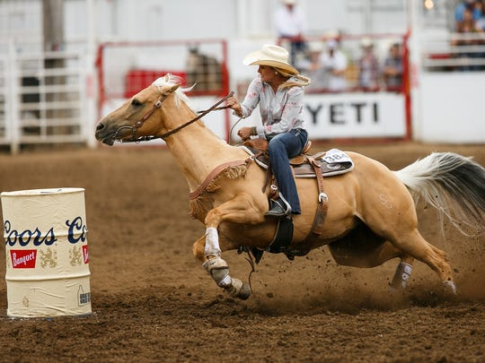 Jordan Minor competes in barrel racing at the St. Paul Rodeo on Wednesday, July 4, 2018.