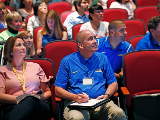 New Superintendent of Carmel Clay Schools Michael Beresford listens to the keynote speaker at the #C4: Connect, Collect, Collaborate, and Create conference, held at Clay Middle School, Wednesday, July 11, 2018.