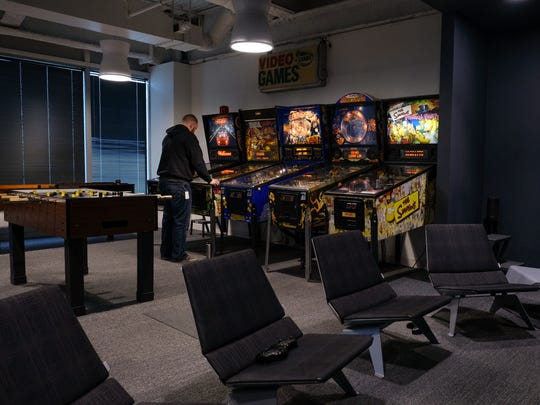 There are numerous games and amenities for tenants' employees inside Southfield Town Center. This game room is in the HelloWorld suite.