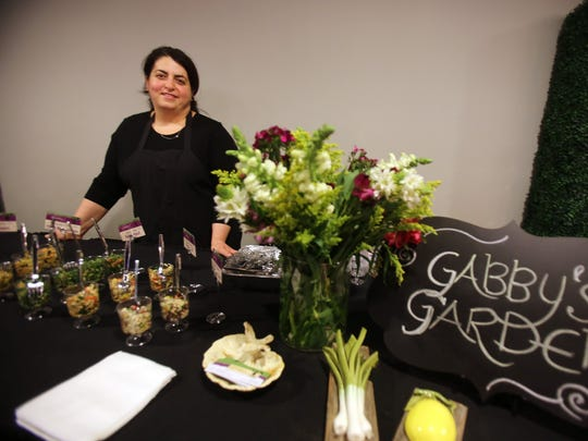 Wes Kassab of Gabby's Garden with her natural, organic specialty salad creations during the Detroit Free Press Feast Thanksgiving tasting event Sunday at the Great Lakes Culinary Center in Southfield.