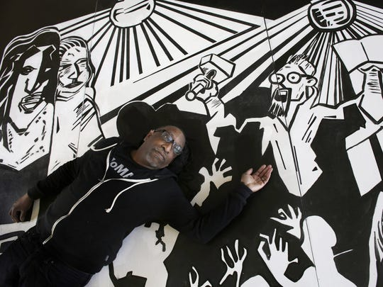 Artist Carl Wilson with part of an installation he is working on at the Carr Center in Detroit.