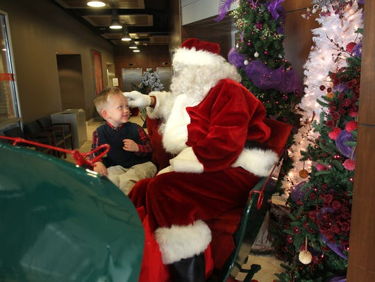 Four-year-old Bentley Wagehoft of Coralville chats