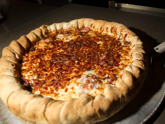 Airliner's Chicago-style meat craver's pizza is seen on Monday, Dec. 22, 2014.