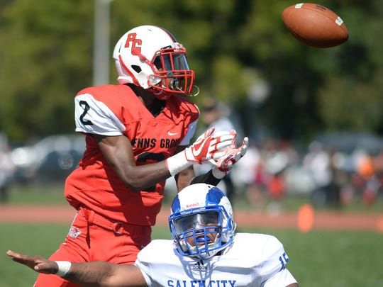 Penns Grove's Jamar Johnson brings in a catch over Salem's Ramere Nock during Saturday's game. 09.23.17.