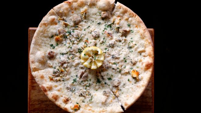 The clam pizza at Slyce in Ardsley Slyce restaurant is an updated version of Ardsley Pizza with artisan pies, craft beers and wine added to the menu.