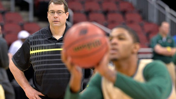 In this March 18, 2015, file photo, UAB head coach Jerod Haase, left, watches as his team practices for an NCAA college basketball tournament game in Louisville, Ky. Haase agreed to become the new head coach at Stanford University.