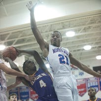 Washington Township senior Najee Wilson attempts to block the shot of Camden's Dustin Singleton in a recent game.