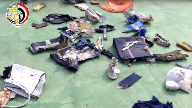 This file still image taken from video posted Saturday, May 21, 2016, on the official Facebook page of the Egyptian Armed Forces spokesman shows some personal belongings and other wreckage from EgyptAir flight 804 in Egypt.