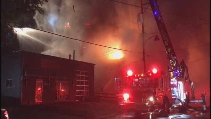 Crews remained on the scene of a massive fire in the