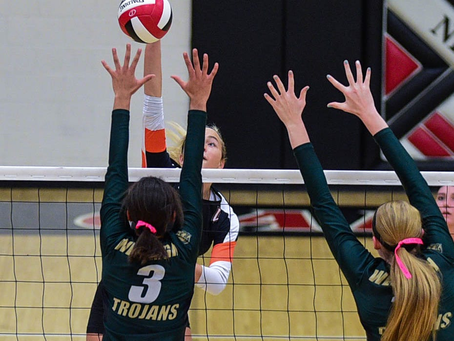 Iowa City West's Mikaela Mabry (3) goes up to block the ball as West Des Moines Valley's Tori Cunningham (11) hits it over at the Class 5A-Region 5 regional finals held at Newton High School on Tuesday, Nov. 4, 2014.
