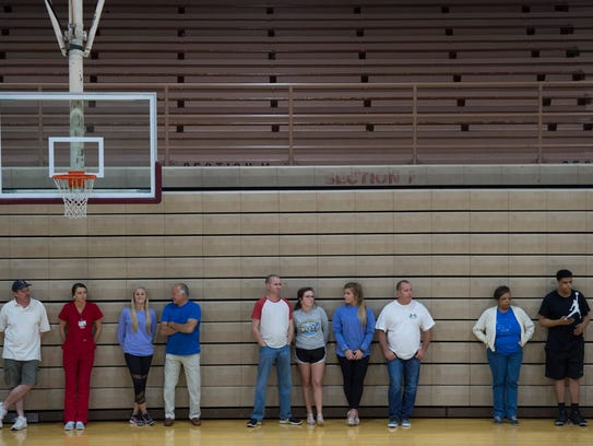 The next group of seniors and parents wait their turn