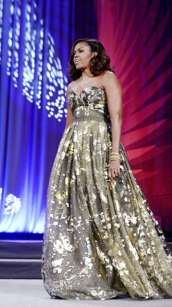 First lady Michelle Obama wore Naeem Khan gown to the