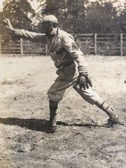 The senior Grits Gresham follows through on a throw apparently during warm-ups before his barnstorming semi-pro baseball team's game circa 1912.