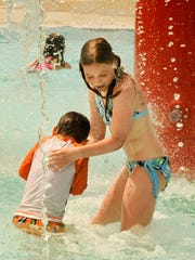 FILE - Olivia Schuh plays in the Manitowoc Family Aquatic Center at Citizen Park with her brother, Simon.