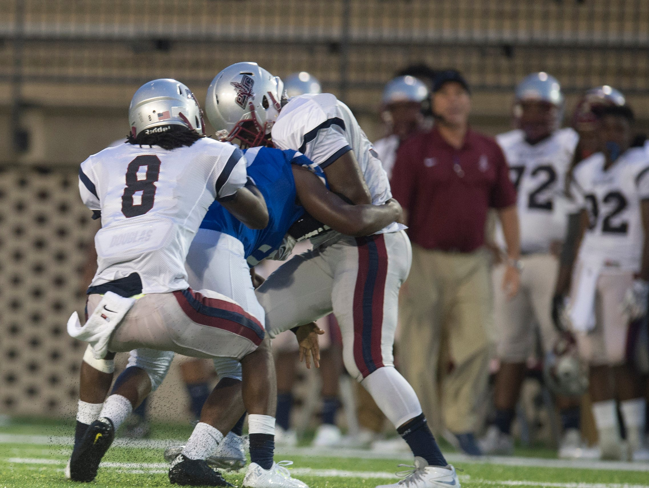 Park Crossing's Prentice James Blue attempts to pull Lanier's Demetrius Brown off of Park Crossing's Jocquez Dixon as a fist fight broke out between them during the AHSAA game between Park Crossing High School and Lanier High School on Friday, Aug. 28, 2015. Three players from each team were ejected form the game.
