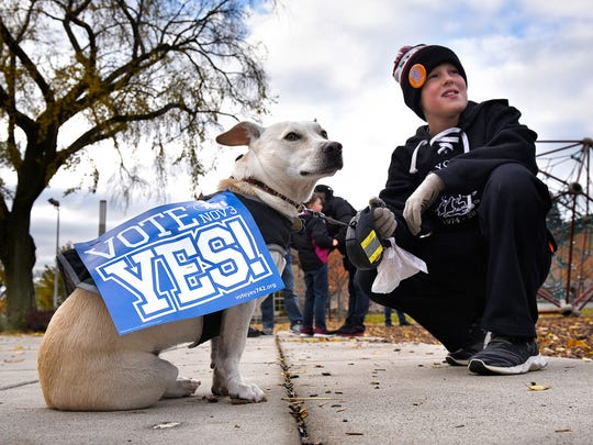 Sean Reagan and his dog Percy attend a rally in support