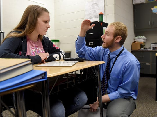 """""""The problem is, they know how to do the math, but they've got to get through all of the junk in the problem to get to what they need and then get the answer,"""" said Northeastern Middle School math teacher Jeff Plummer, seen here working with 8th grade algebra student Lydia Sanderson."""