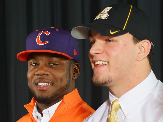 Belton-Honea Path High's Kendall Joseph, left, and Eric Boggs had plenty to smile about Wednesday on national signing day.
